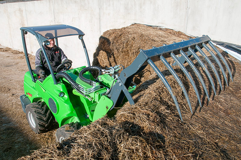 Avant 600 series compact loader with silage grab