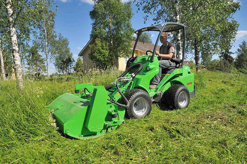 Avant series 600 compact loader with flail mower